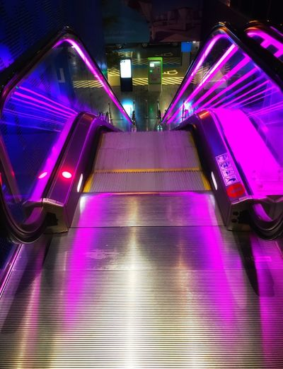 Light escalation Urban Escalator Illuminated Architecture Purple Lighting Equipment The Way Forward Built Structure Indoors  Pink Color Night No People Direction Staircase Transportation Multi Colored Pattern Railing Steps And Staircases Connection Technology Diminishing Perspective