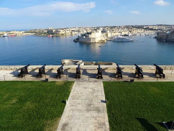 Water Built Structure Architecture Day Sea Sky Building Exterior Outdoors Nature High Angle View Cloud - Sky City No People Grass Beauty In Nature Horizon Over Water Cityscape Malta Saluting Battery