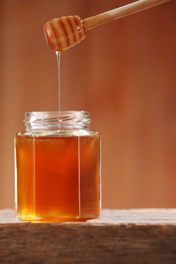 Close-Up Of Honey In Jar On Table
