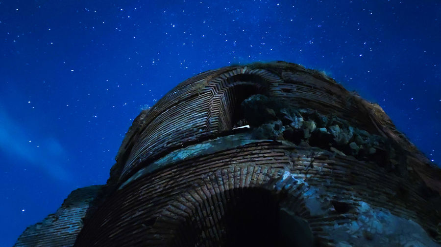 Low angle view of an old church ruin from the 5th century and the night sky