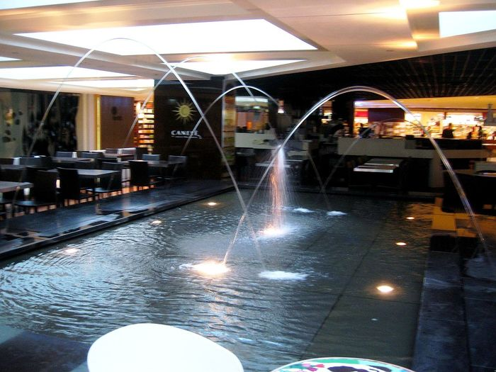 Hotel Shopping Mall & Lobby View Fine Art Photography Fountain Illuminated Interior Decorating Interior Design Lighting Equipment Man Made Fountain Restaurants Interior Capturing Motion
