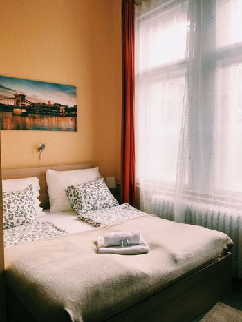 This is a hostel private room. Comfortable and gray for the budget. Vacations Hostel Hotel Interior Design Private Room Holiday EyeEm Selects Furniture Indoors  Domestic Room Pillow Home Interior Bed Bedroom Relaxation Home Showcase Interior Lighting Equipment Comfortable