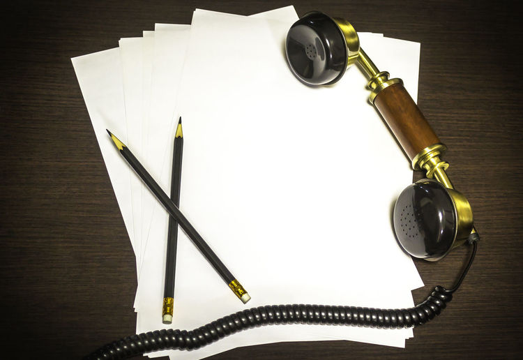 Vintage earphone on wooden background with empty paper and two pencil Bussiness Call Communication Concept Connection Design Document Earphones Education Hold The Line Holding Phone Note NotePad Office Operator Pancils Papers Paperwork Phone Reminder Secretary Telephone Vintage Wooden Texture Work