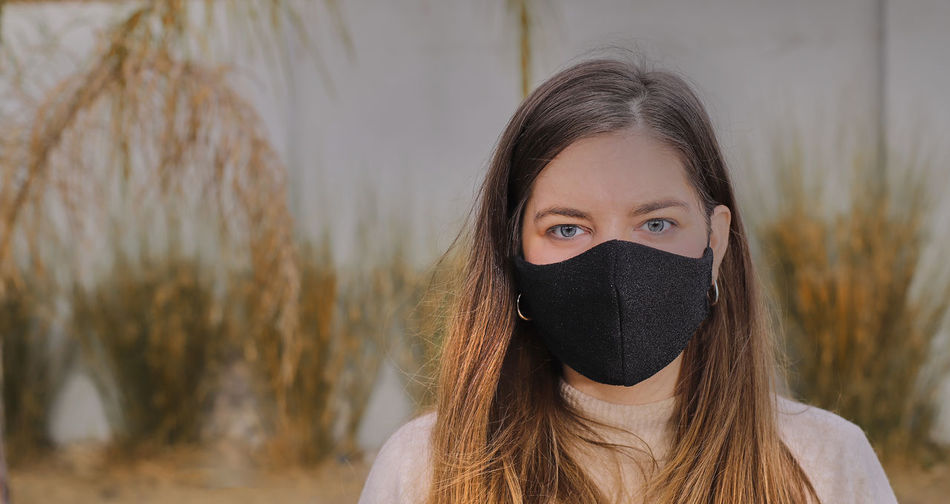 Portrait of beautiful woman covering face