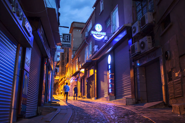 Architecture Building Exterior Night Illuminated Built Structure City Street Direction The Way Forward Road Sign Footpath Lighting Equipment