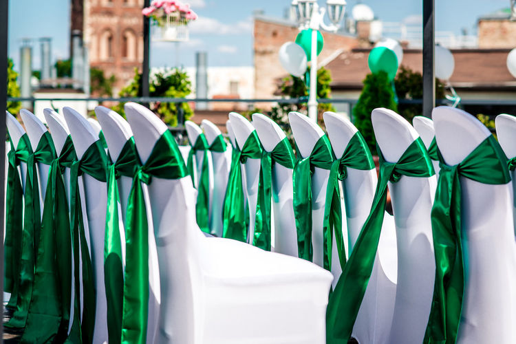Green Tied Bow On Chairs Arranging At Wedding