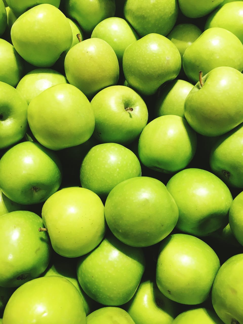 fruit, green color, healthy eating, full frame, abundance, backgrounds, food, food and drink, large group of objects, freshness, no people, granny smith apple, apple - fruit, day, close-up, indoors
