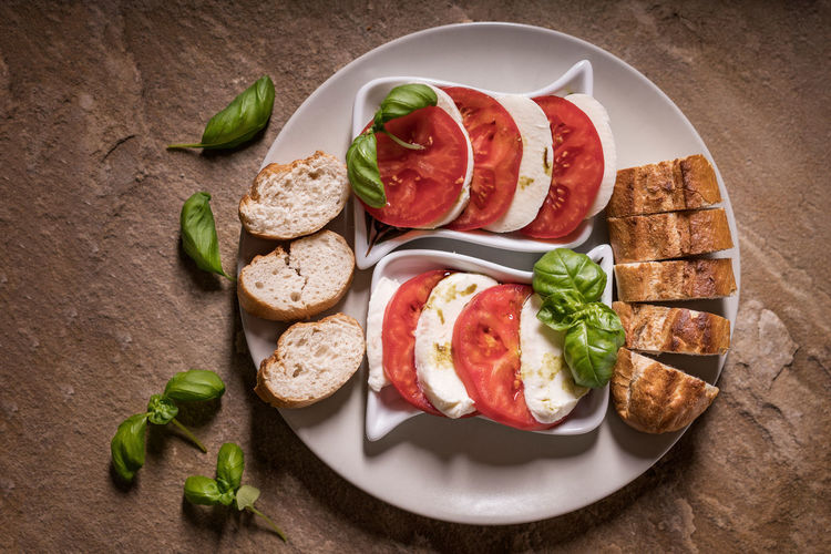 Tomatoes and Mozzarella Basil Green Red Rustic Salad Arranges Baquette Bread Food Food Still Life Foodphotography Mozzarella No People Ready-to-eat Stone Material Tomatoes