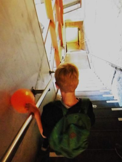Backview Balloon Boy Casual Clothing Children Fun Holding Innocence Lifestyles Light And Shadow Real People Stairs