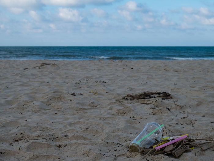 Garbage on the beach trash ,plastit ,bottle ,foam ,rubbish has pollute.selective focus Backgrounds Bag Beach Bottle Cap Coast Colorful Dirt Dump Eco Human Pile Plasic Nature Sand Sea Shore Tourist Trash Waste