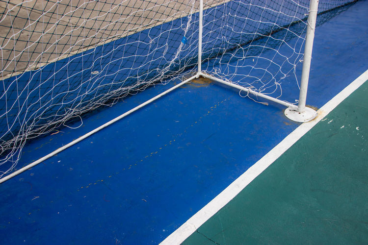 Goal Nets Futsal in futsal field. Football Blue Close-up Court Day Futsal Net - Sports Equipment Outdoors Soccer Sport