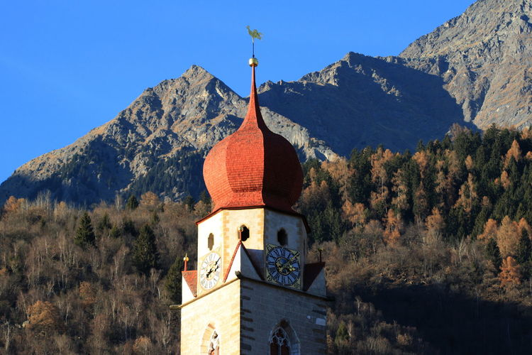 Low angle view of church by mountains