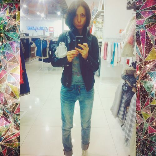 Young Women Girl Reflection In The Mirror Jeans Black Hair Shopping Mall Smart Phone Shopping Bag Self Portrait Selfie Self Portrait Photography Photographing Shopaholic Denim Posing Mobile Phone