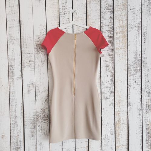 Dress Hanging On Wooden Wall