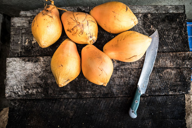 Fresh Fruit right on the beach! Beach Life Bold Chopping Board Close-up Day Exotic Fruit Food Food And Drink Fresh Freshness Fruit Hack Healthy Eating High Angle View Indoors  Machete No People PawPaw Rustic Sri Lanka Studio Shot Table Tropical Vegetable Wood - Material