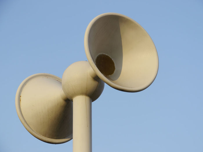 Close-up of white megaphones