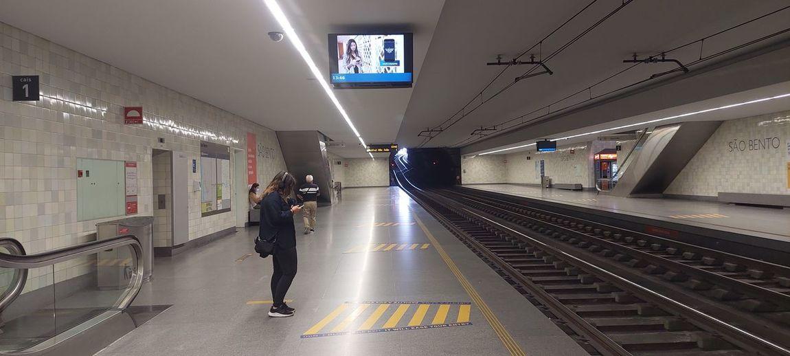 Man walking on railroad station platform