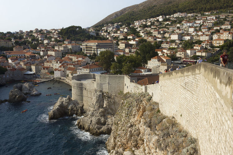Dubrovnik Dubrovnik, Croatia Croatia Outdoors Cliff Cliffside Walls Fortified Wall Fortified Walls Cityscape Top View View From The Top Architecture Building Exterior Built Structure Water Building City Nature Residential District Sea Town Day Sky No People House Land Waterfront TOWNSCAPE