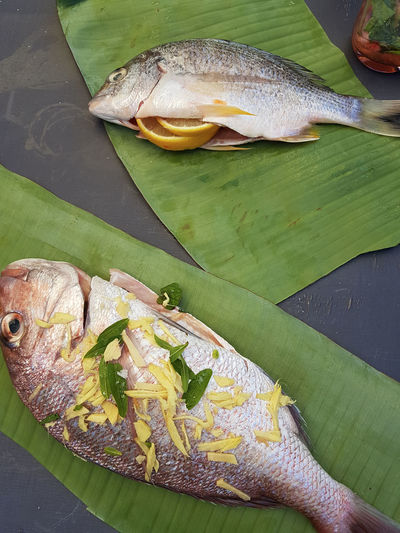 Fresh fish ready to be wrapped in banana leaf and cooked in woodfire oven Backyard Cooking Fresh Fish SNAPp Seafood Banana Leaf Bream Close-up Fish Food And Drink Fresh Fresh Seafood Freshness Girl Healthy Eating No People Raw Food Seafood Spring Springtime Summer Whole Fish