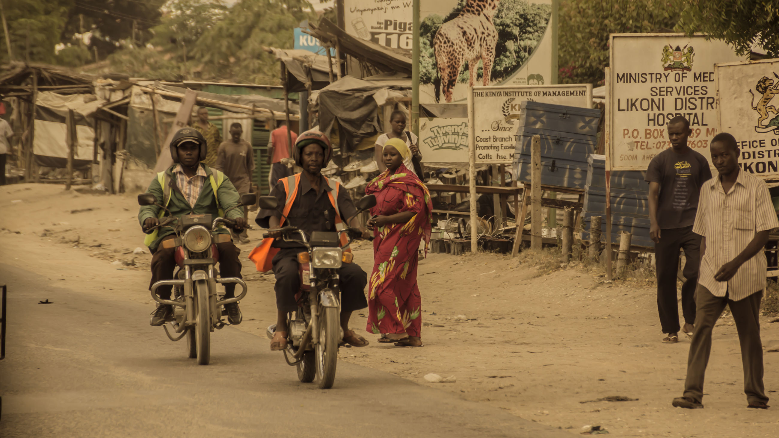 real people, transportation, group of people, land vehicle, men, mode of transportation, lifestyles, street, full length, people, casual clothing, bicycle, city, women, day, road, group, leisure activity, outdoors, ride, riding