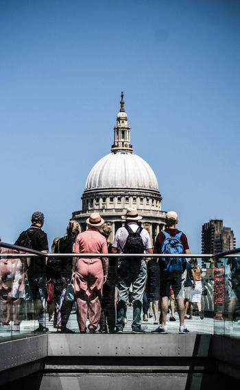 People in front of st paul cathedral against clear sky