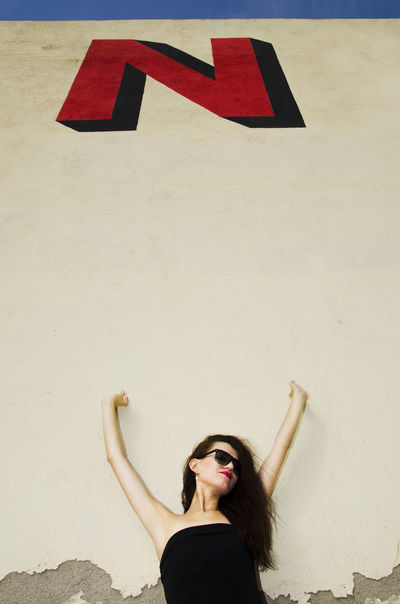 Big Letters Big Simbol Black Dress Black Sunglasses City Life City Street Expanding Expansion Girl Girl And Wall Girl Having Fun Hands In The Air Hands Up Letter Letters Letters In The City Lifestyles N Never Now Portrait Young Girl