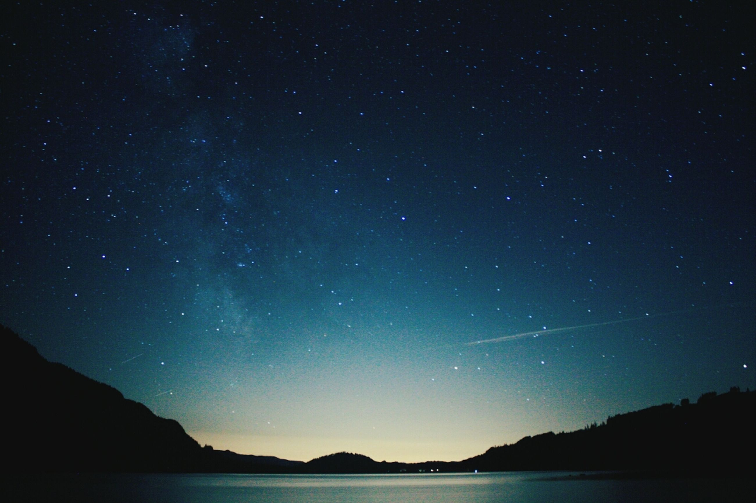 night, scenics, tranquil scene, star - space, beauty in nature, tranquility, star field, astronomy, water, sky, nature, idyllic, galaxy, waterfront, star, silhouette, majestic, space, mountain, lake