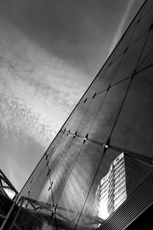 Low Angle View Architecture Cloud - Sky Built Structure Modern Building Exterior City Reflection Photography Atmospheric Scene Capture The Moment From My Polnt Of View In The City Black And White Photography Black And White The Architect - 2017 EyeEm Awards Cityscape Samsung Galaxy S7 Edge Paris ❤ France🇫🇷 Black And White Collection  Black And White Photogaphy Beaugrenelle Center