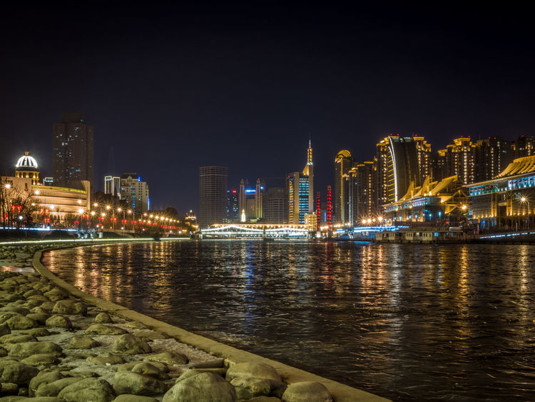 Frozen river 海河 Haihe in Tianjin, China. Architecture Building Exterior City City Life Cityscape Frozen River Haihe River Illuminated Long Exposure Modern Architecture Night Night Photography No People Reflection River Skyscraper Sony Rx100 M3 Tianjin Tianjin China Travel Destinations Urban Skyline Water