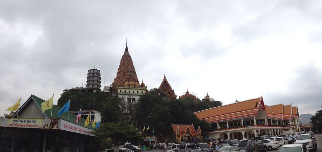 Low Angle View Of Wat Tham Sua Against Cloudy Sky