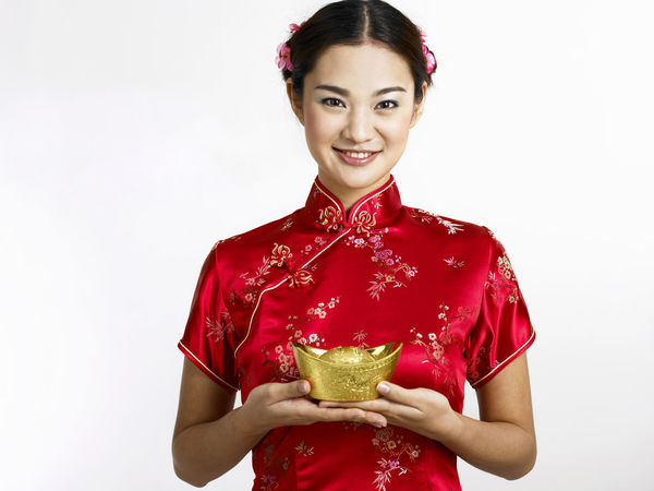 chinese woman holding gold ingot Gold Gong Xi Fa Cai New Year Prosperity Treasure Beautiful People Beautiful Woman Cheerful Cheongsam Chinese New Year Fortune Front View Hair Bun Happiness Heritage Looking At Camera One Person Portrait Qipao Red Smiling Standing Studio Shot White Background Young Adult