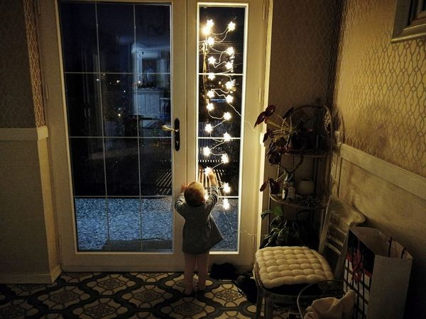 Window Door Indoors  Doorway Built Structure Night Architecture Looking Through Window Love Childhood Family Happiness Illuminated Christmas Decoration Christmas Ornament Lights Christmas Star Christmas Lights Domestic Life House Christmas Decorations Christmastime Indoors