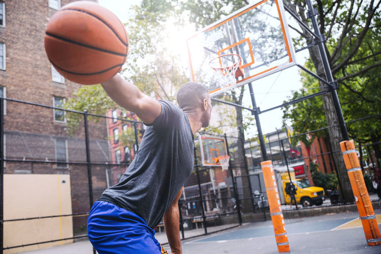 Young man playing basketball at court