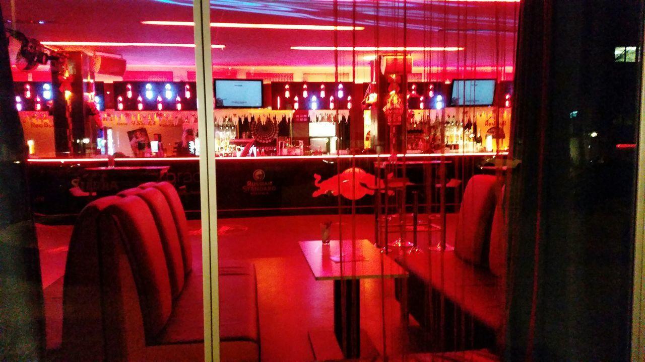 restaurant, illuminated, night, bar, cafe, chair, bar - drink establishment, window, indoors, bar counter, nightlife, no people, architecture, city, neon