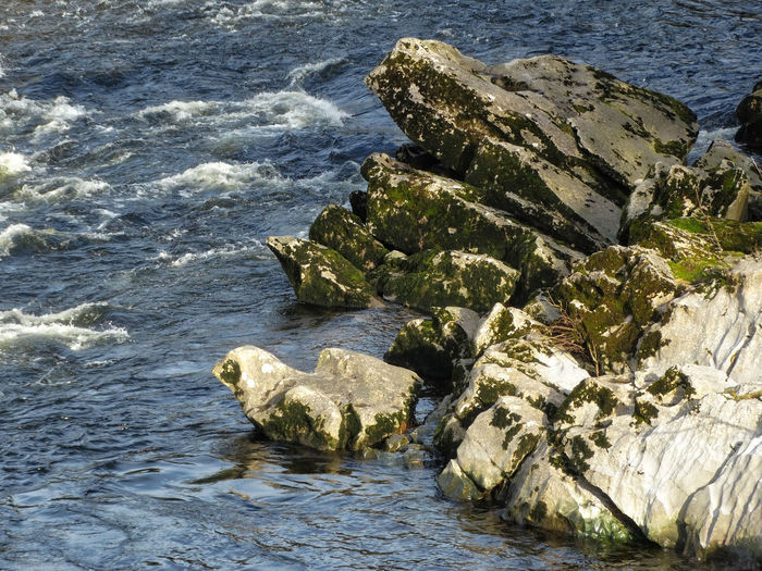 Rock and water scene. Water Rock Rock - Object Sea Solid Nature No People Day Rock Formation Motion Wave Marine Outdoors Beauty In Nature Rocky Rocks Rock River Lake Riverside