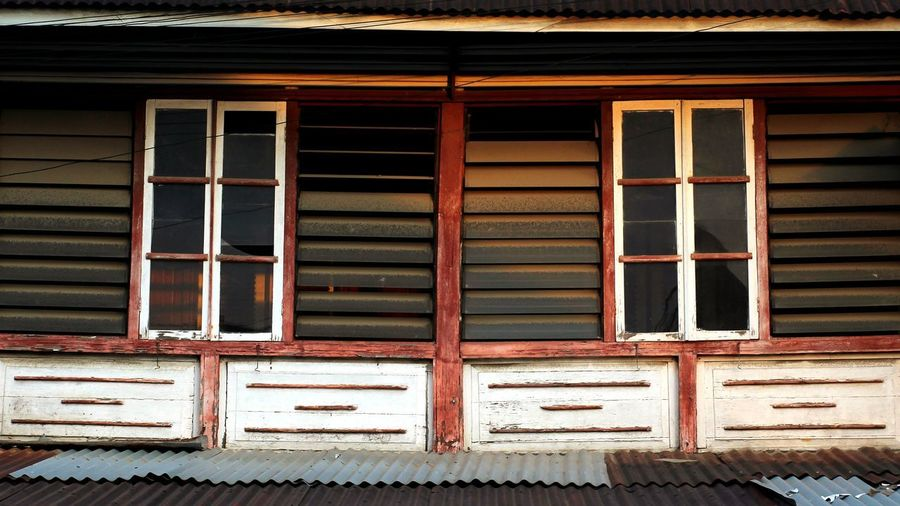 Low angle view of closed window of old building
