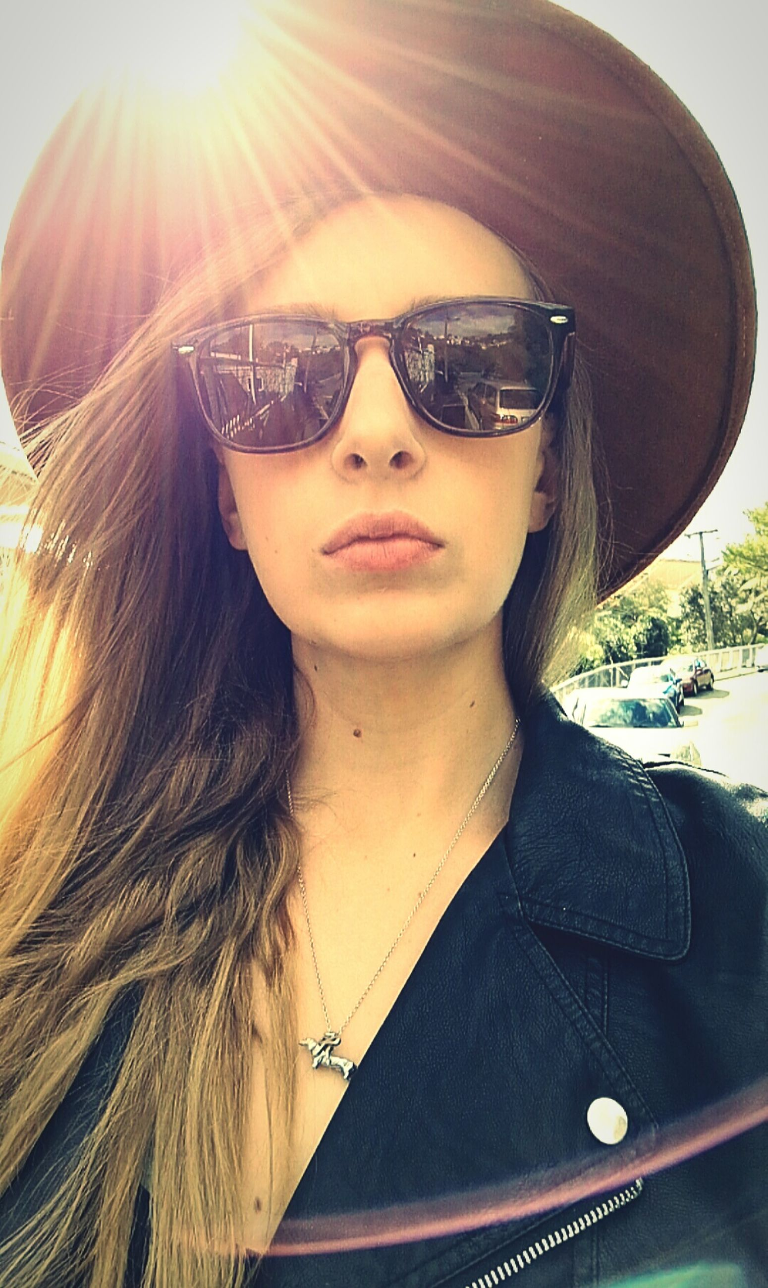 young adult, young women, long hair, front view, headshot, sunglasses, looking at camera, sunbeam, portrait, lifestyles, leisure activity, transportation, sunlight, beauty, person, sunny, mode of transport, vacations, puckering, casual clothing, outdoors, day, confidence, sun, summer