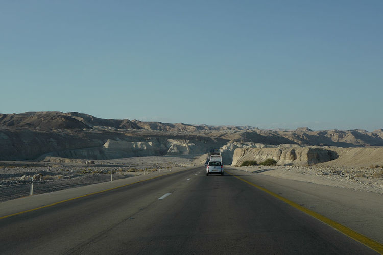 Jordan Beauty In Nature Blue Car Clear Sky Copy Space Day Dead Sea  Desert Driving From My Car Window Israel Land Vehicle Landscape Mountain Nature Negev  No People On The Road Outdoors Road Road Marking Scenics Sky The Way Forward Transportation