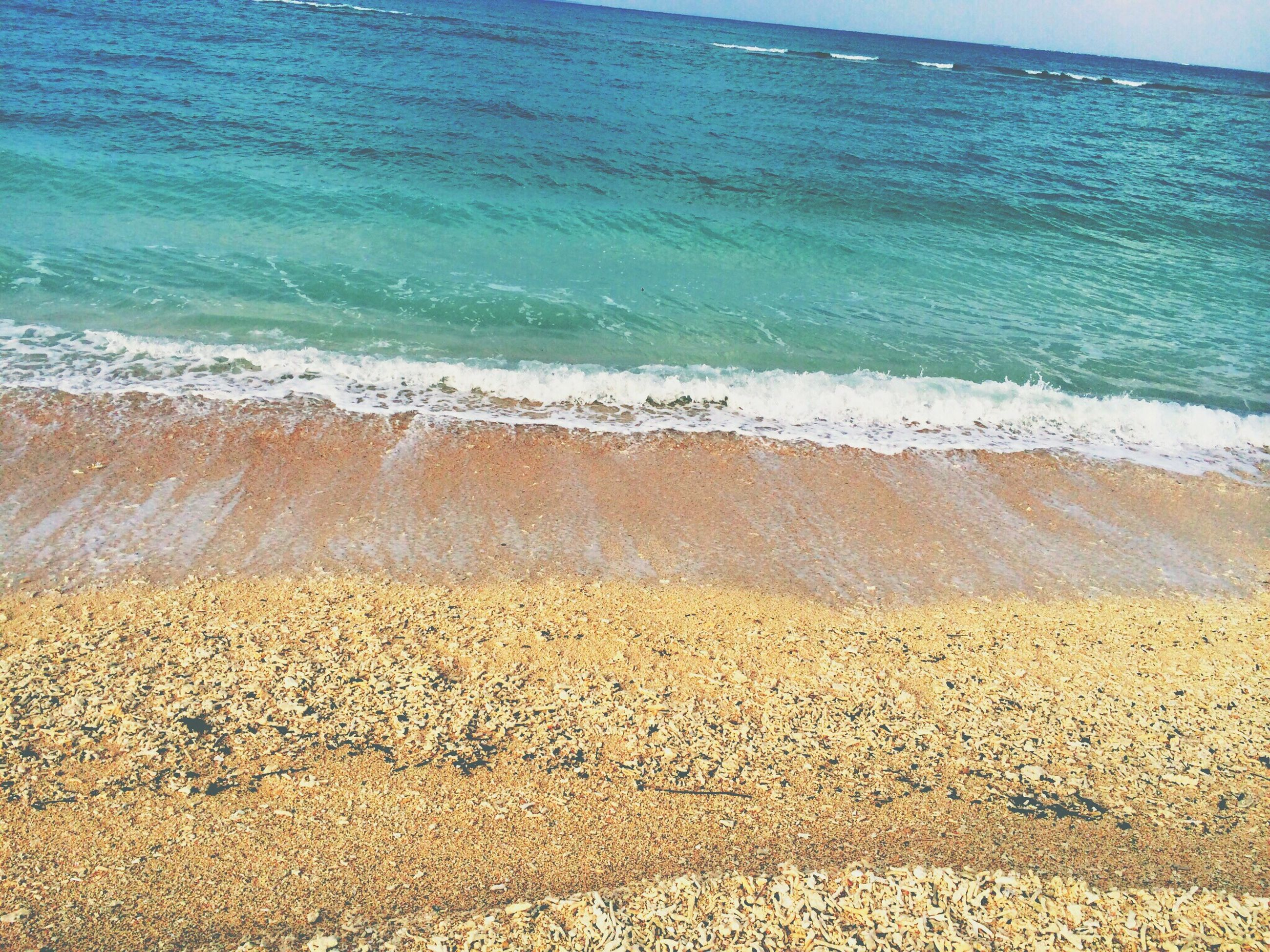 sea, beach, water, sand, horizon over water, shore, wave, tranquility, scenics, beauty in nature, surf, tranquil scene, nature, coastline, idyllic, blue, sky, day, outdoors, no people