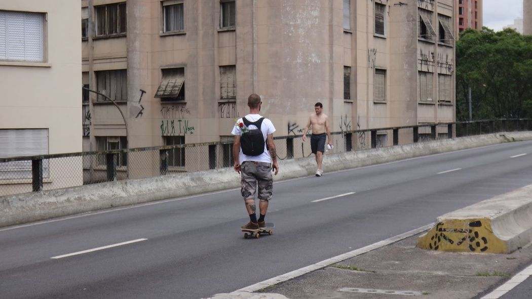 ELEVADO MINHOCAO SAO PAULO BRAZIL MARCH 2016 Architecture Building Exterior Built Structure Casual Clothing City City Life Day EyeEm Team Full Length Leisure Activity Lifestyles Person Road Side View Street Transportation Walking Young Adult Young Men