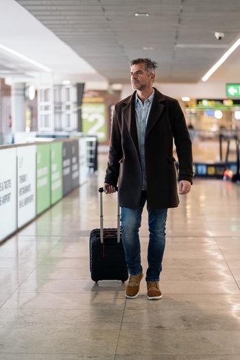 Full length portrait of a man walking on floor