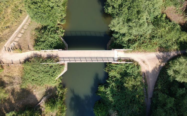 Bridge over the river from a drone Beauty In Nature Bridge Built Structure Connection Day Green Color Growth High Angle View Nature No People Outdoors Plant Reflection Scenics - Nature Tranquil Scene Tranquility Transportation Tree Water