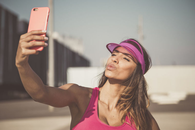 Attractive Beauty Camera Cellphone Photography Face Instagram Isolated Lifestyles Mobile Phone Outdoors Photo Messaging Pink Color Portrait Self Portrait Photography Selfie Smart Phone Summer Technology Urban Young Adult Young Woman