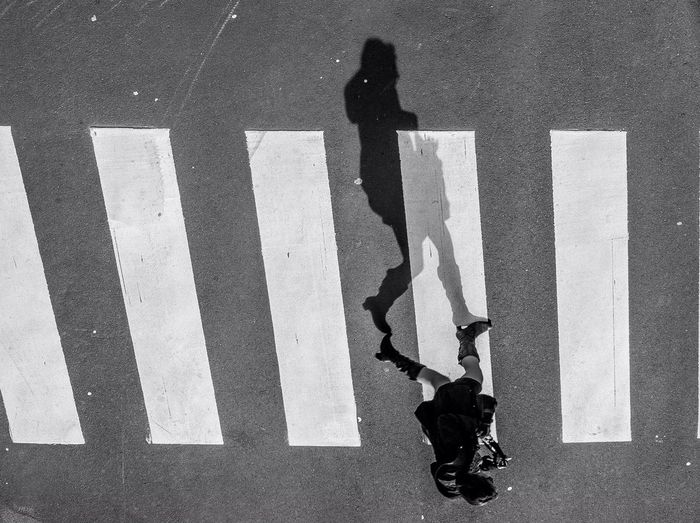 High angle view of woman on zebra crossing