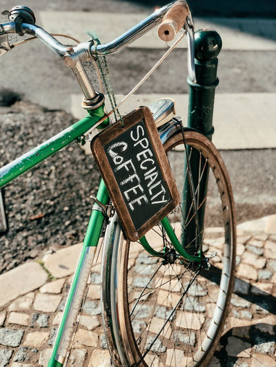 Close-up of bicycle parked against brick wall