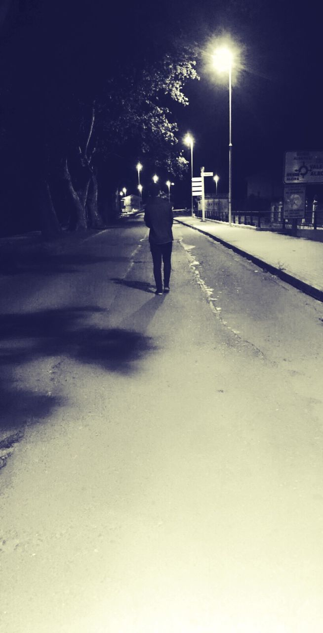 illuminated, night, street light, walking, road, full length, one person, the way forward, outdoors, winter, real people, city, tree, nature, sky, people