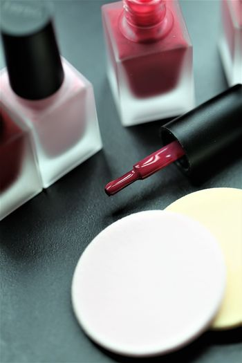 No People Table Still Life Red Lipstick Indoors  Selective Focus Close-up Writing Instrument Group Of Objects Nail Paper Nail Polish Pen Beauty Product Make-up High Angle View Black Color Choice Small Group Of Objects