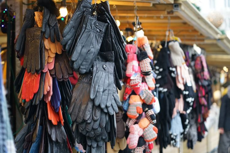Gloves hanging in market for sale
