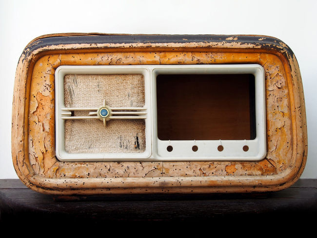 An old broken wooden vintage radio receiver with a cracked brown case and missing parts Radio Abandoned Antique Close-up Indoors  No People Nostalgia Obsolete Old Radio Receiver Retro Styled Ruined Single Object Still Life Studio Shot Table Technology The Media Wood - Material