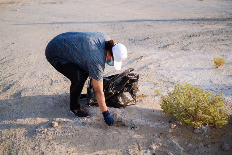 Side view of man working on road